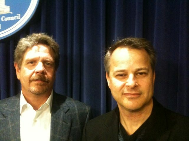Writers Guild President John Wells (left) and guild member Greg Fideler at Los Angeles City Hall on Dec. 15, 2010.