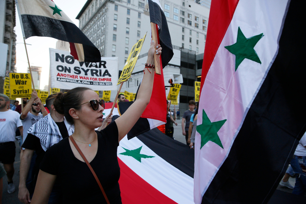 Syrian-Americans express their anger at the missile strikes on their homeland during an anti-war rally opposing the military strikes by Western countries in Syria, in downtown Los Angeles, Saturday, April 14, 2018. On Saturday, those commemorating Syria's independence from France in 1946, called the missile strikes by the U.S., Britain and France illegal.