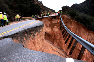 Caltrans and state emergency officials inspect a damaged section of Highway 330 near Highland on Thursday, Jan. 6, 2011. It could take up to two years to repair the storm-damaged roadway.