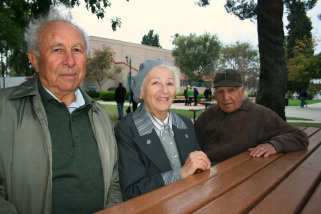 Elya Gelman, 83, from left, with wife Sofia Gelman, 79, and friend Marc Skibinsky, 85, after lighting candles at the Babi Yar memorial at Plummer Park in West Hollywood, Sunday, April 11, 2010.