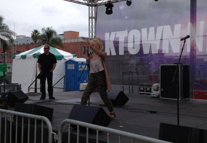 Artist Lydia Paek rehearses Friday afternoon ahead of the debut of the KTown Night Market, billed by organizers as