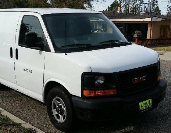 A photo of the vehicle believed to have been stolen by jail escapee Bac Duong. The white 2008 GMC Savana utility vehicle had a license plate number of 8U66466, though plates and stickers may have been removed.