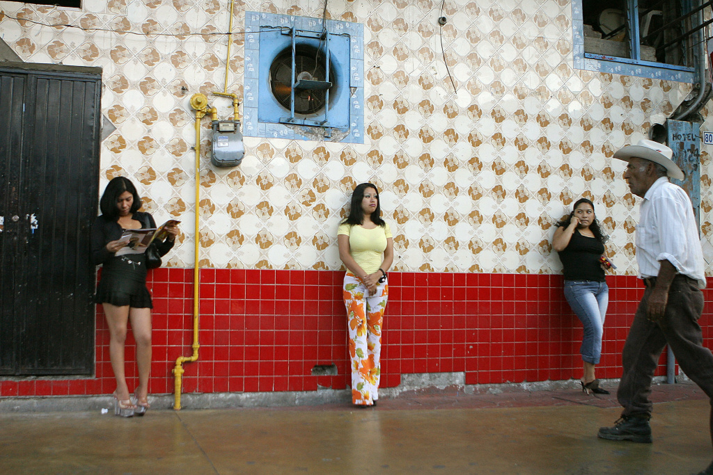 Mexican prostitutes wait for clients on a street of Tijuana city, Baja California state, 06 August 2007. Prostitution is one of the activities that attract more people who live in the US side of the border.
