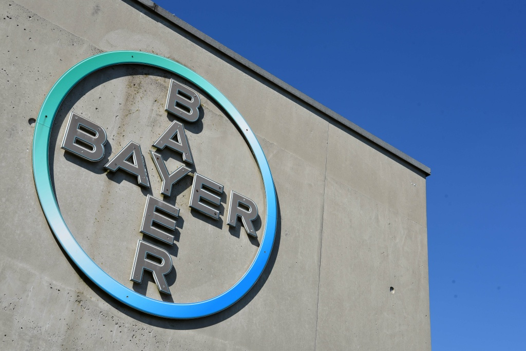 The picture taken on September 8, 2016 shows a sign with the logo at the headquarter of German chemical company Bayer. What are the implications of the Monsanto-Bayer merger?
