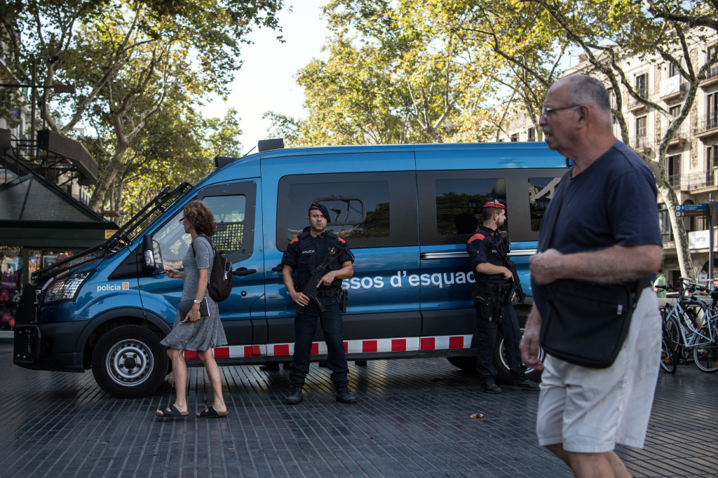 Armed police patrol Las Ramblas following Thursday's terrorist attack in Barcelona, Spain. Spanish police have also killed five suspected terrorists in the town of Cambrils to stop a second terrorist attack.