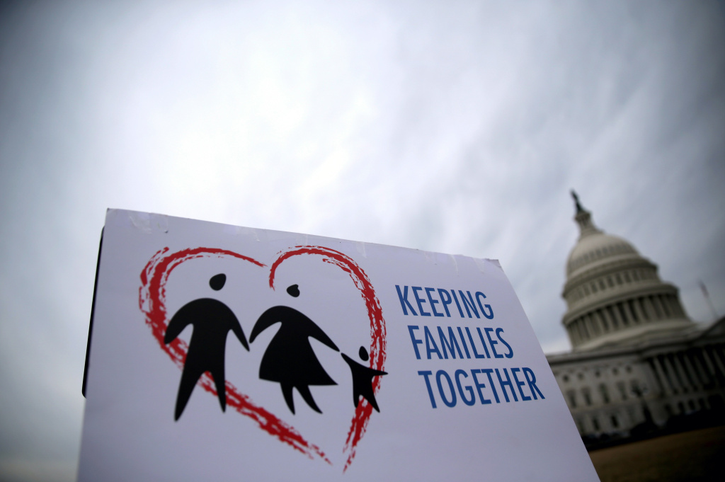 A sign is seen during a news conference on immigration reform at the east front of the U.S. Capitol March 11, 2014 on Capitol Hill in Washington, DC. The Fair Immigration Reform Movement (FIRM) held the news conference to
