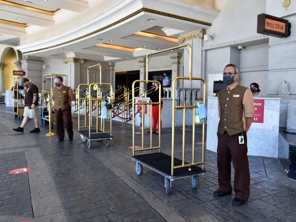 Hotel staff stand ready to receive guests on June 4, 2020, at Caesars Palace in Las Vegas. U.S. hotels hit all-time lows in occupancy and in revenue per available room last year.