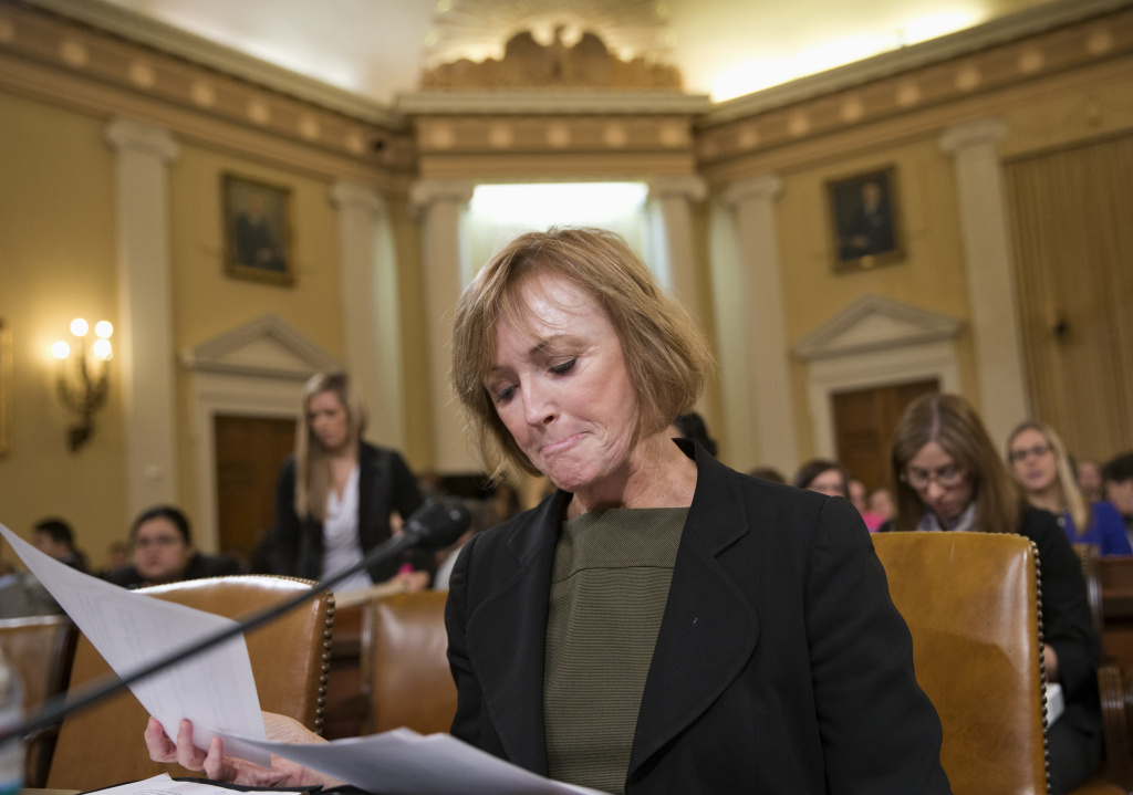 Marilyn Tavenner, the administrator of the Centers for Medicare and Medicaid Services, goes over her notes on Capitol Hill in Washington, Tuesday, Oct. 29, 2013, prior to testifying before the House Ways and Means Committee hearing on the implementation of the Affordable Care Act. Stressing that improvements are happening daily, the senior Obama official closest to the administration's malfunctioning health care website apologized Tuesday for problems that have kept Americans from successfully signing up for coverage.