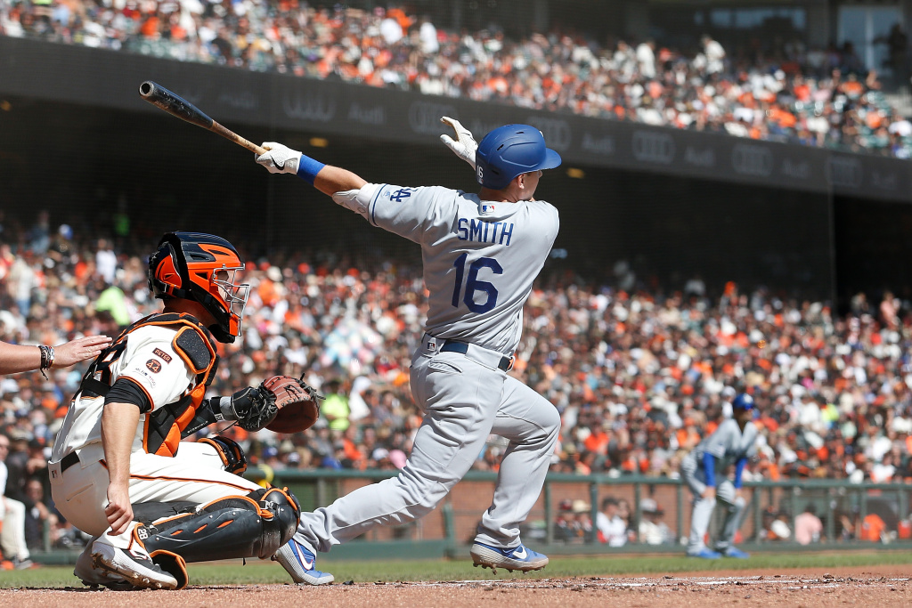 Will Smith #16 of the Los Angeles Dodgers hits a two-run home run in the top of the first inning against the San Francisco Giants at Oracle Park on September 29, 2019 in San Francisco, California.