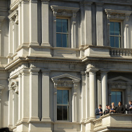 Obama administration employees stand on a balcony of the Eisenhower Executive Office Building in hopes of catching a glimpse of President-Elect Donald Trump's arrival at the White House November 10, 2016 in Washington, DC.