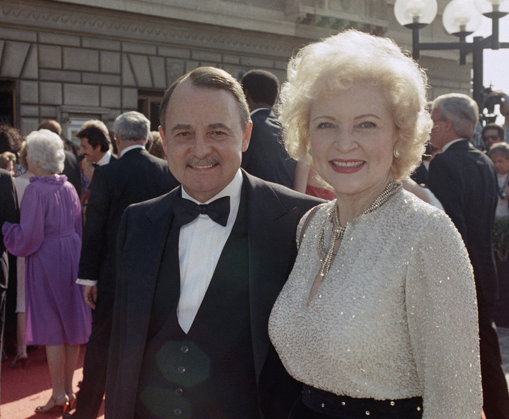 File: This Sept. 22, 1985, file photo shows John Hillerman, left, and Betty White, right, arriving at Emmy Awards in Pasadena.
