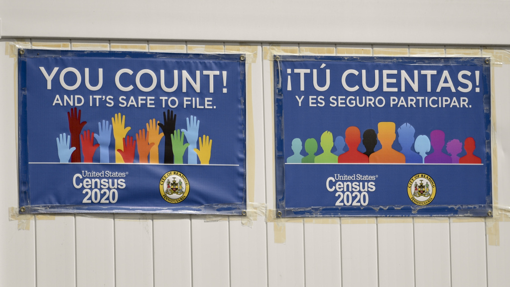 Signs promoting the 2020 census hang on a fence in Reading, Pa., in September. The Census Bureau has found irregularities in this year's census responses that could affect the counting of millions of people.