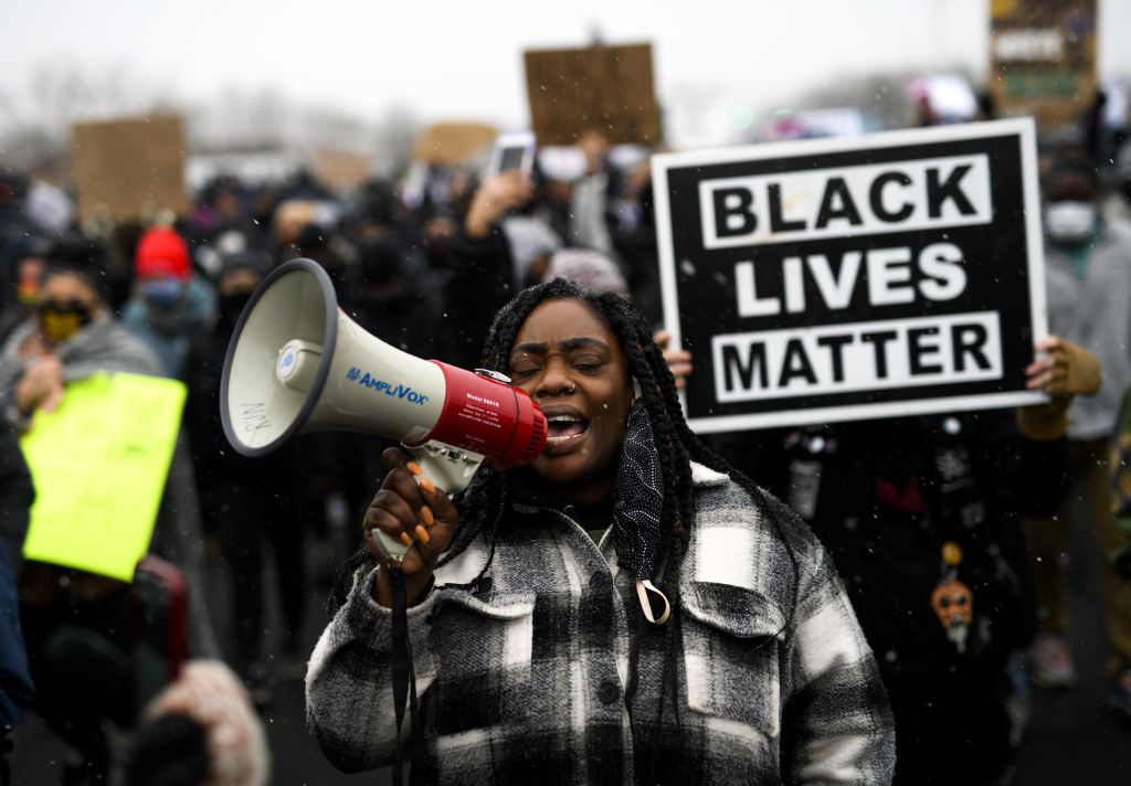 Protesters march outside the Brooklyn Center police headquarters on April 13, 2021 in Brooklyn Center, Minnesota. Demonstrations have become a daily occurrence since Daunte Wright, 20, was shot and killed by Brooklyn Center police officer Kimberly Potter on Sunday.