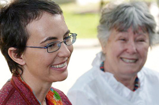 In this handout image provided by Giffords Campaign - P.K. Weis, U.S. Rep. Gabrielle Giffords (D-AZ) sits with her mother Gloria Giffords (R) the day after the launch of NASA space shuttle Endeavour and the day before she had her cranioplasty surgery, outside TIRR Memorial Hermann Hospital May 17, 2011 in Houston, Texas.