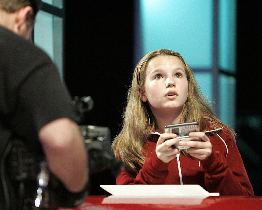 Morgan Pozgar of Claysburg, Pennsylvania, uses a phone to send a text message as she competes in the LG National Texting Championship, 21 April 2007, at the Roseland Ballroom in New York, sponsored by LG Mobile Phones.