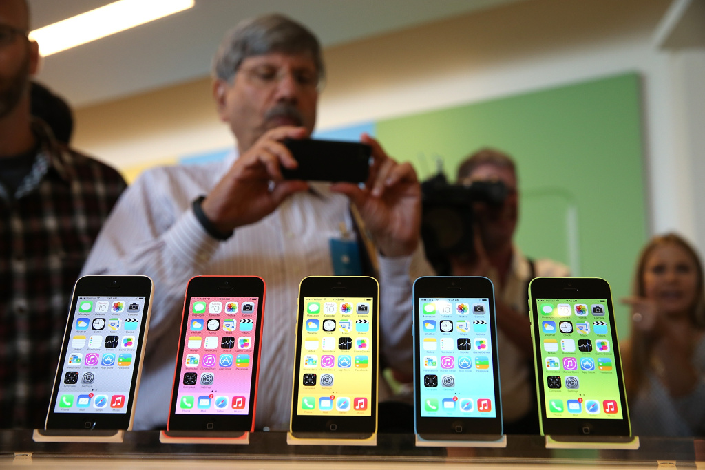 The new iPhone 5C is displayed during an Apple product announcement at the Apple campus on September 10, 2013 in Cupertino, California. The company launched the new iPhone 5C model that will run iOS 7 is made from hard-coated polycarbonate and comes in various colors and the iPhone 5S that features fingerprint recognition security.