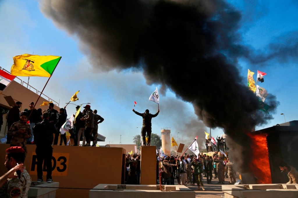 Protesters burn property in front of the U.S. embassy compound, in Baghdad, Iraq on Dec. 31, 2019.