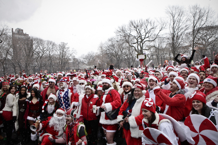 Revelers dressed as Santa Claus drink inside at a bar in the East Village neighborhood during the annual SantaCon bar crawl event on Dec. 14, 2013 in New York City. In New York some community groups have established a 'Santa Free' zone that urges bars not to serve alcoholic beverages to people participating in order to dissuade incidents of public vomiting and urination in the streets.