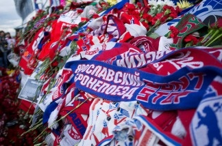 A Lokomotiv scarf is placed amongst flowers and candles at the 'Arena 2000' on Sept. 8 in Yaroslavl, Russia. Ice hockey fans all over the world are mourning after most of the Lokomotiv Yaroslavl ice hockey team were killed in a plane crash.