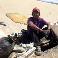 Abimael Martinez, who was deported from Riverside, Calif., with the hole he dug to live in beneath the banks of Tijuana's fetid river canal.