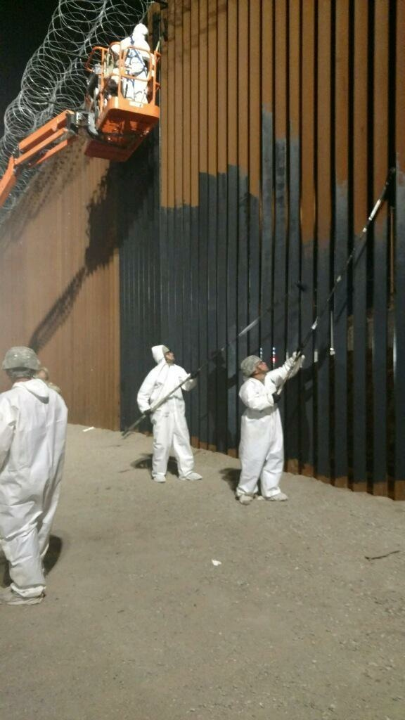 Soldiers from the 15th Engineering Company apply paint to the border wall near the Calexico West port of entry in California.