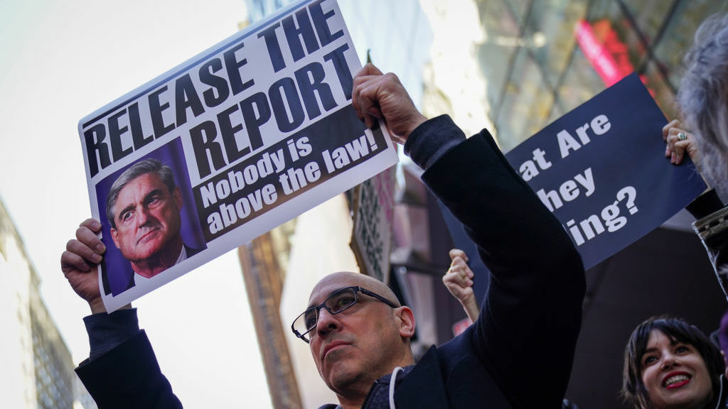 Activists participate in a 'Release the Report' rally in Times Square on April 4 in New York City.