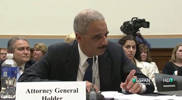 Rep. Louis Gohmert and Attorney General Eric Holder clashed over the House's decision to hold Holder in contempt in 2012. The exchange included finger wagging and warnings against lectures.