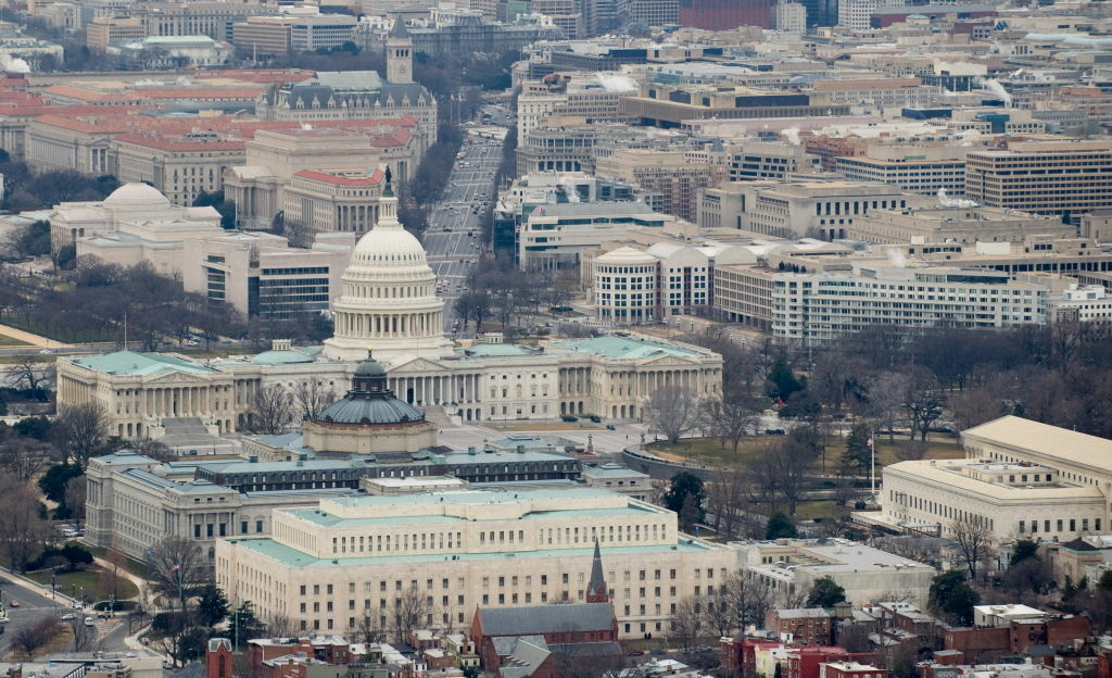 The U.S. Capitol building and Congressional office buildings are seen from the air over Washington, D.C. Some freshman lawmakers use the couches in these office buildings as a home away from home. (SAUL LOEB/AFP/Getty Images)