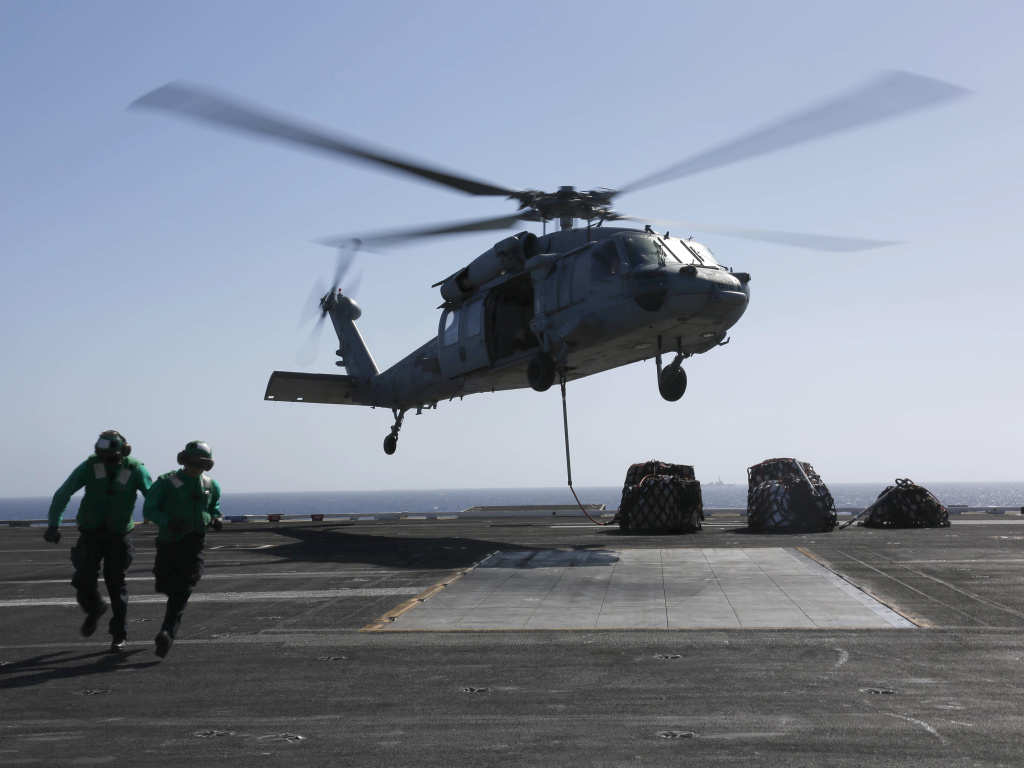A MH-60S Sea Hawk helicopter takes off from the aircraft carrier USS Abraham Lincoln in the Red Sea. The Abraham Lincoln Carrier Strike Group was recently deployed to U.S. Central Command area of responsibility as tensions between the U.S. and Iran escalate. On Monday, the State Department ordered additional troops to the Middle East.