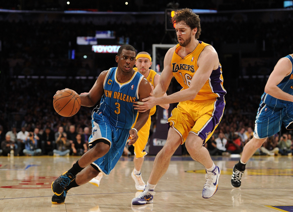 File: Chris Paul #3 of the New Orleans Hornets drives on Pau Gasol #16 of the Los Angeles Lakers in Game Two of the Western Conference Quarterfinals in the 2011 NBA Playoffs on April 20, 2011 at Staples Center in Los Angeles, California.