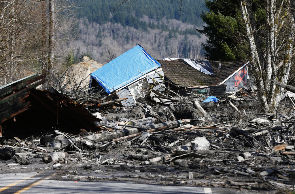 ARLINGTON, WA - MARCH 23:  A house sits destroyed in the mud on Highway 530 next to mile marker 37 on March 23, 2014 near Arlington, Washington.  (Photo by Lindsey Wasson/The Seattle Times-Pool/Getty Images)