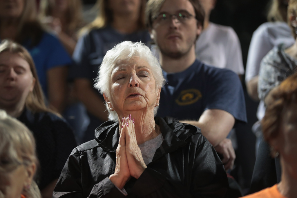 Guests attend a prayer services at the La Vernia High School Football stadium to grieve the 26 people killed at the First Baptist Church of Sutherland Springs, Texas on November 5, 2017.