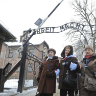 Holocaust survivors walk outside the gate of the of the Auschwitz Nazi death camp in Oswiecim, Poland, on Tuesday. Some 300 Holocaust survivors traveled to Auschwitz for the 70th anniversary of the death camp's liberation by the Soviet Red Army in 1945.