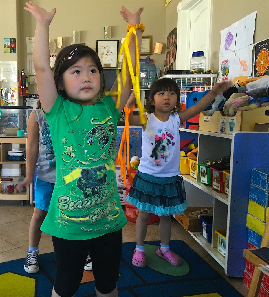 Preschoolers start their day with ribbon stretching at Joy of Learning Academy in Rowland Heights.