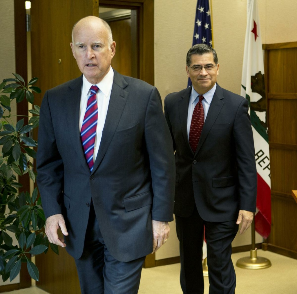 Gov. Jerry Brown with Rep. Xavier Becerra (D-Los Angeles), his choice for California attorney general.