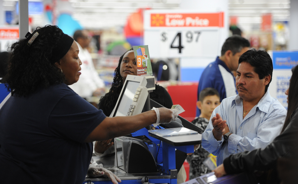 An employee at a Walmart in the Crenshaw district of Los Angeles on Black Friday.