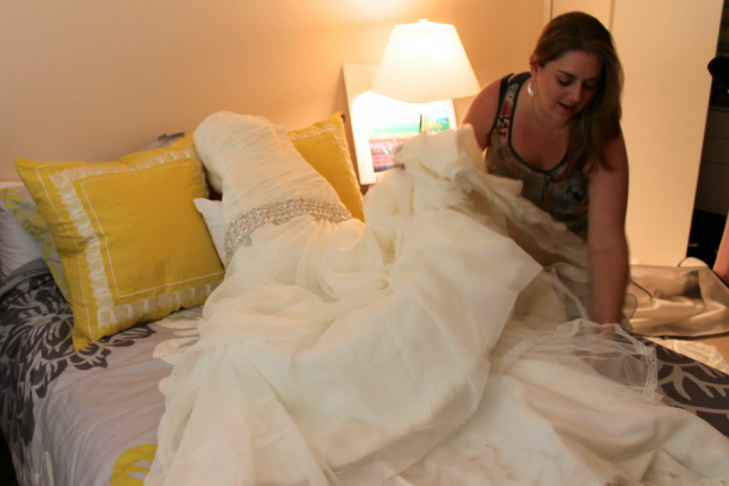 Jackie Lantz hopes her wedding dress will sell on Recycled Bride. Lantz is selling her dress for $750. She originally paid $2,400 for the dress.