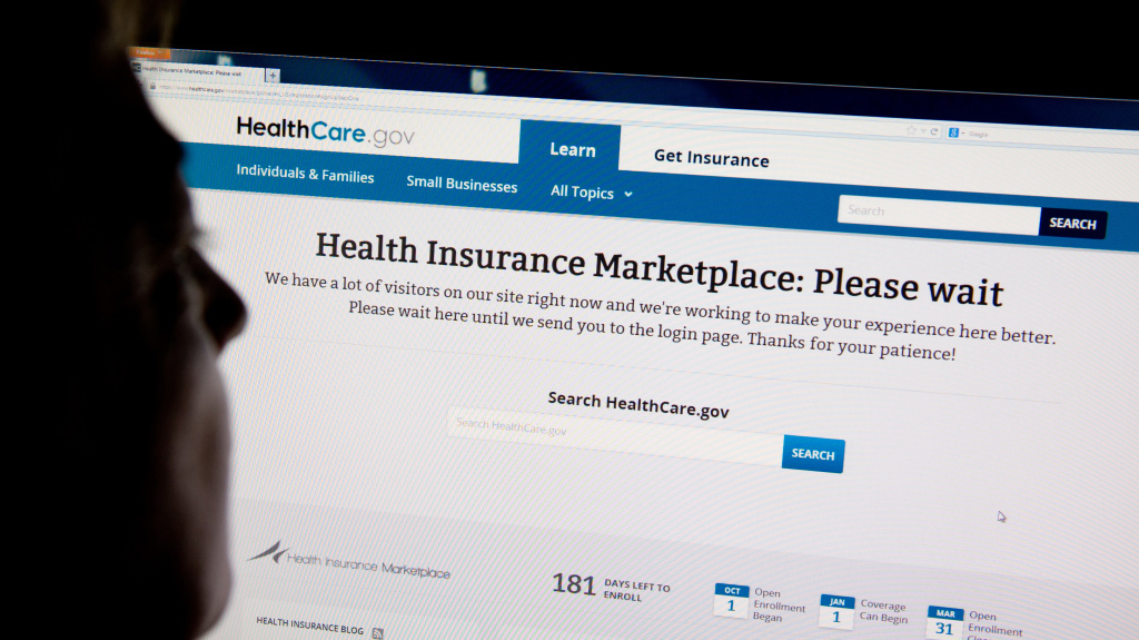 A woman looks at the HealthCare.gov insurance exchange site on Oct. 1 in Washington.