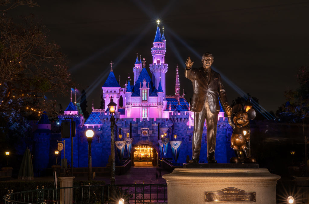 In this handout photo provided by Disneyland Resort, a view of Sleeping Beauty Castle in Disneyland Park illuminated during a special live streamed moment to welcome Cast Members back to the resort on April 26, 2021 at Disneyland Resort in Anaheim, California.