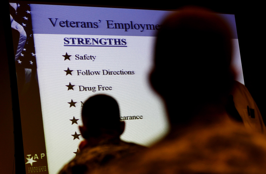 FORT BRAGG, NC - AUGUST 2:  Soldiers look over a list of attributes about veterans in the civilian workplace during a Transition Assistance Program class on August 2, 2010 in Fort Bragg, North Carolina. The Transition Assistance Program (TAP) helps US troops nearing the end of their military service transition into civilian life by offering job-search assistance, employment classes, and related services.  (Photo by Chris Hondros/Getty Images)
