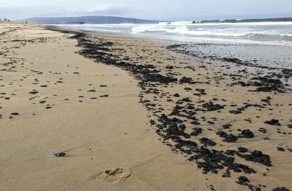 A stretch of Manhattan Beach was closed Wednesday after clumps of oil were found washed ashore. The beach was reopened Friday afternoon.