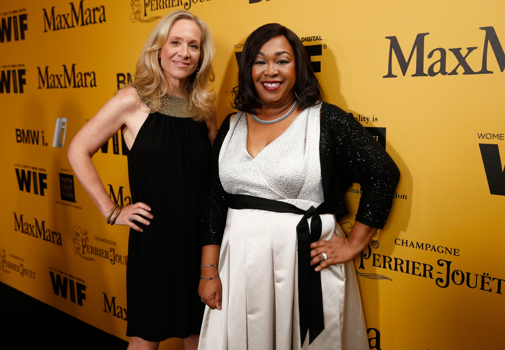 Producer Betsy Beers (L) and writer/producer Shonda Rhimes attend Women In Film 2014 Crystal + Lucy Awards.