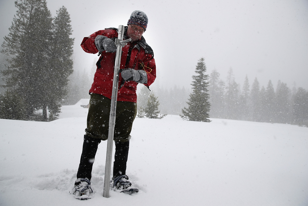 TWIN BRIDGES, CA - MARCH 30:  Frank Gehrke, Chief of the California Cooperative Snow Surveys Program for the Department of Water Resources, takes a sample of the snowpack on March 30, 2017 near Twin Bridges, California. The Sierra snowpack survey conducted on Thursday revealed a snow depth of 94.4 inches with water content of 46.1 inches, which represents 183 percent of the April long-term average.  (Photo by Justin Sullivan/Getty Images)