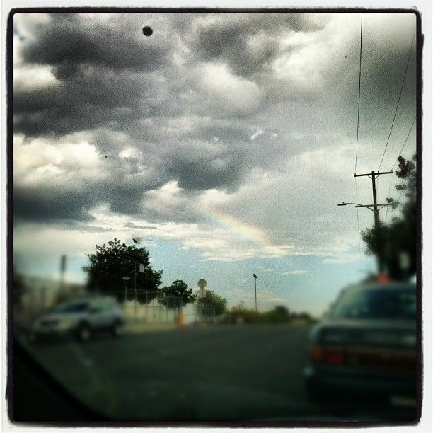 Clouds over Los Angeles delivering rain and a little rainbow