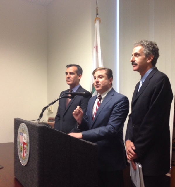 LA City Controller Ron Galperin, center, is joined by Mayor Eric Garcetti, left, and City Attorney Mike Feuer, right, to discuss a dispute over $40 million in DWP controlled money.