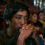 In anguish: Tears ran down the cheeks of a man as he waited with other survivors Tuesday for a flight out of Tacloban, the Philippines, which was devastated by Typhoon Haiyan.