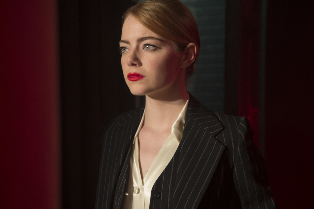 "Emma Stone as Mia Dolan in ""La La Land."" In this scene, she steps out on stage to perform her one-woman show ""So Long Boulder City."""