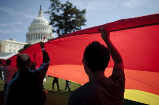 LGBT rights supporters march in front of Congress.