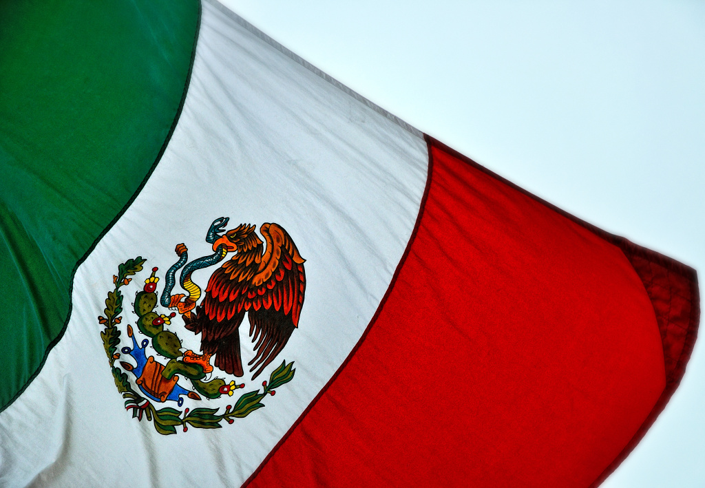 File: Bandera de México. The flag of Mexico outside the consulate in Austin.