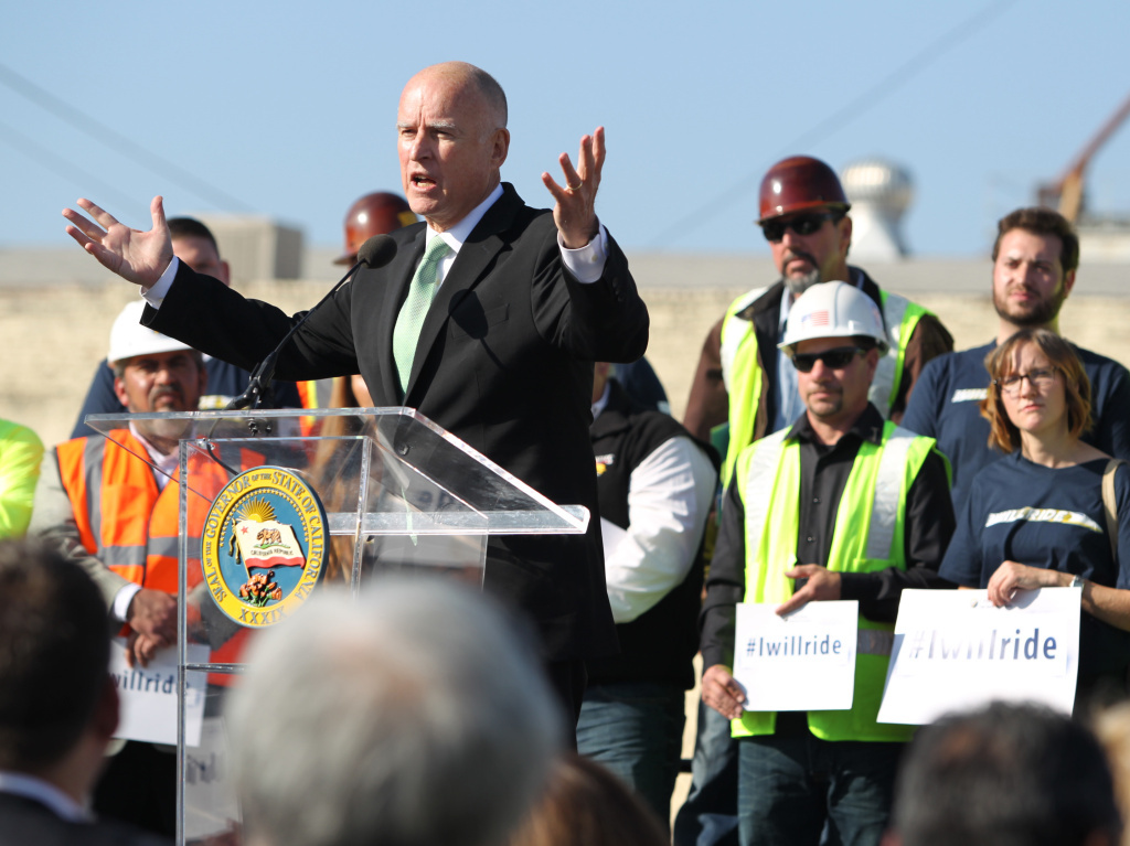 Gov. Jerry Brown speaks to the crowd during the California High Speed Rail Authority ground breaking event in Fresno, Calif. The $68 billion project faces challenges from Republicans in Congress, and from Central Valley farmers suing to block the train from crossing their fields.